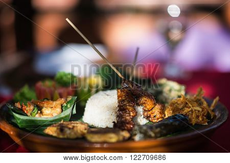 Asian Cuisine - selection of Asian foods served on a platter. Selective focus shallow depth of field