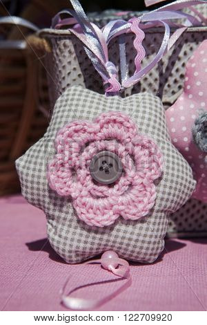 textile and woolen pink stars with a button in the middle
