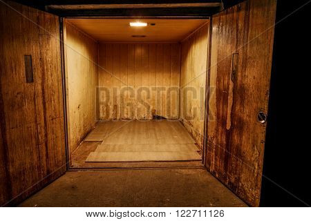 Opened rusty old transport elevator