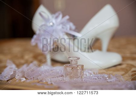 beautiful white wedding shoes and bride's accessories