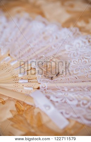 bride's accessories for wedding day. lace and perfume