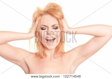 Closeup portrait of blonde young girl 20-25 year old shouting, pressing head over white. Caucasian woman posing in studio. Isolated