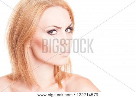 Closeup portrait of frown young woman posing over white. Emotion portrait. Isolated