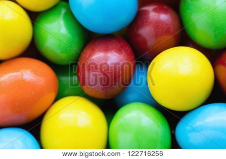 Colorful background of assorted rainbow Choco coated peanut top view