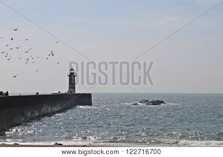 a view to atlantic ocean and the lighthouse in Foz do Douro, Portugal ** Note: Visible grain at 100%, best at smaller sizes
