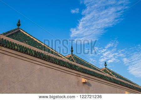 Colorful moroccan Marrakesh the colors highlited by the time of golden hour with a blue sky and some clouds.