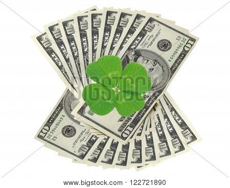 Clover leaf and dollars on white surface background