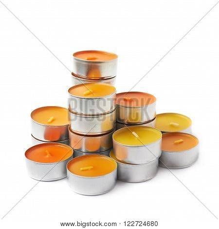 tealight paraffin wax orange candle isolated over the white background