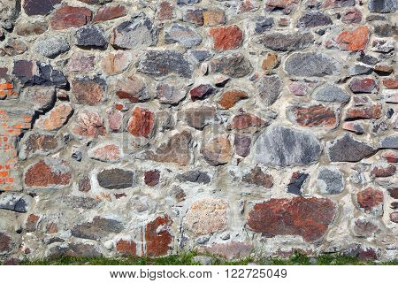 old wall of the fortress, built of stones, background