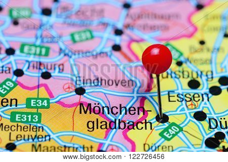 Photo of pinned Monchen-gladbach on a map of Germany. May be used as illustration for traveling theme.
