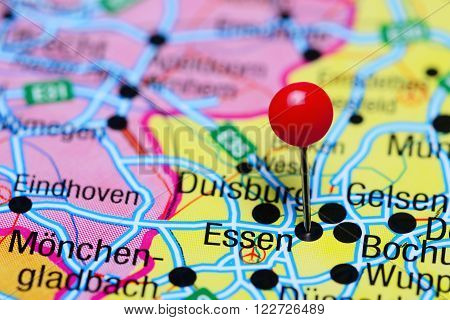 Photo of pinned Essen on a map of Germany. May be used as illustration for traveling theme.