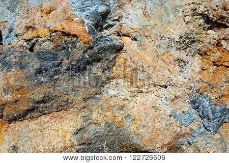Surface of the rock with grey gold and brown tint for background