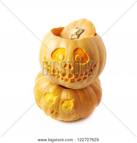 Two Jack-O-Lantern pumpkins, one on top of another, composition isolated over the white background