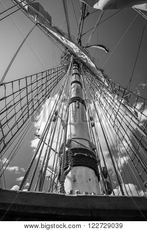 Mast with sails of an old sailing vessel black and white photo