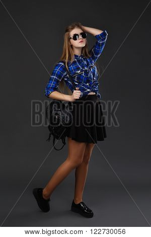 Full-lenght Portrait Of A Girl In A Plaid Shirt And Black Skirt