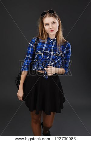 Portrait Of A Girl In A Plaid Shirt And Black Skirt
