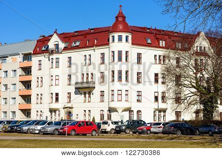 Kalmar Sweden - March 17 2016: The architecture along Vegagatan with cars parked along the street.