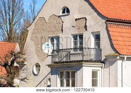 Kalmar Sweden - March 17 2016: A house in need of some tender loving care. The plaster on the facade is breaking up and flaking badly.