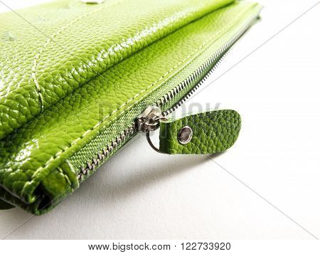 Handmade zipper on green leather purse isolated on white background