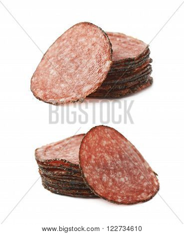 Pile of multiple salami sausage slices isolated over the white background, set of two different foreshortenings