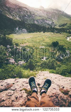 Feet Selfie running shoes Traveler relaxing on cliff mountains outdoor with aerial view forest on background Lifestyle Travel concept adventure vacations