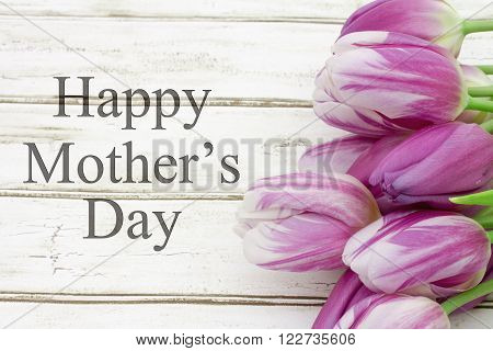 Happy Mother's Day Greeting Some tulips with weathered wood and text Happy Mother's Day