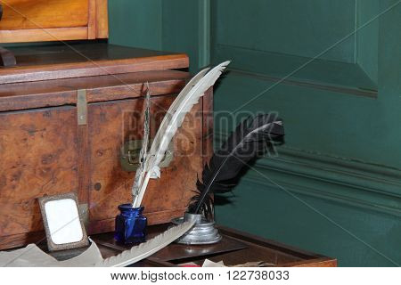 A Vintage Writing Desk with Feather Quill Ink Pens.