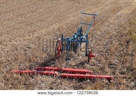 A Hand Steered Farming Plough with a Wooden Harness.