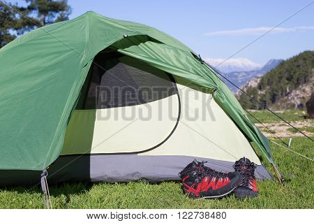 Camping on the mountain top, the backpack is next to the tent.