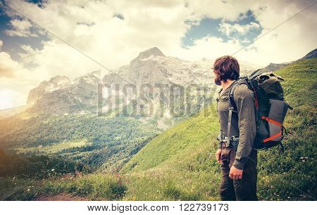 Man Traveler with backpack hiking Travel Lifestyle concept mountains on background Summer journey adventure vacations outdoor