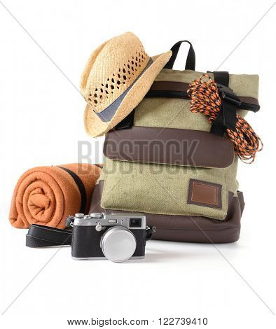Tourism concept. Backpack, rug and camera isolated on white background