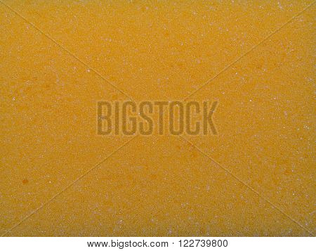 yellow porous sponge for cleaning and Drugova, closeup