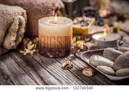Burning candles for aromatherapy session on wooden board