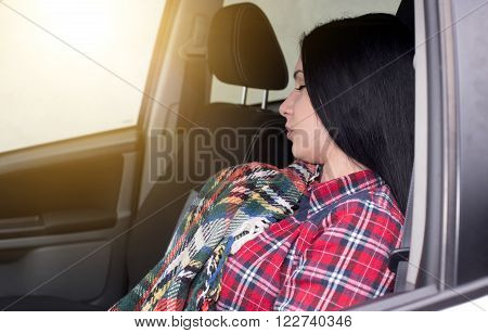 Woman Sleeping In The Car
