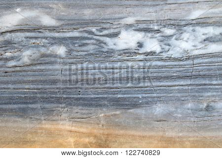 Closeup abstract background texture photo of grainy marble with natural limestone pattern and yellow shade