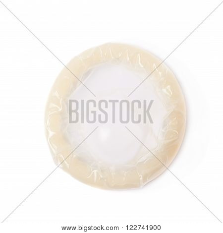 Rolled latex condom isolated over the white background