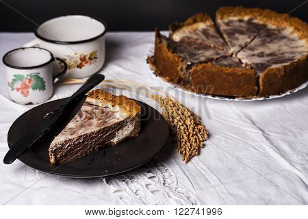 marble cheesecake with cream cheese and chocolate in a rustic style