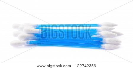 Pile of multiple blue cotton swabs buds isolated over the white background