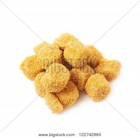 Pile of breaded crab ball snacks isolated over the white background