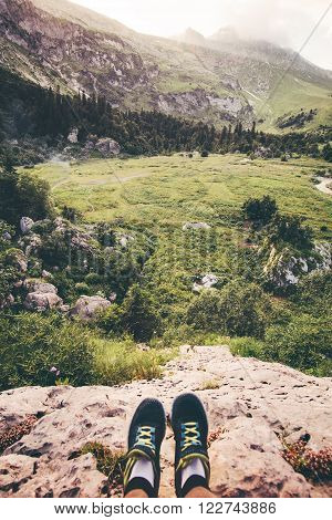 Feet Selfie Traveler relaxing on cliff mountains outdoor with aerial view on background Lifestyle hiking Travel concept summer vacations adventure