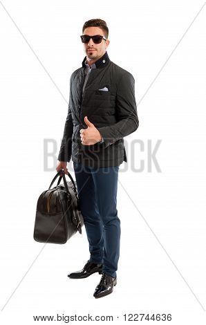 Confident Sales Man Ready To Traves Showing Thumbs-up