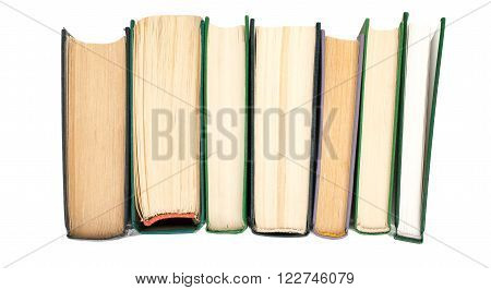 Pile of books isolated on white background, top view