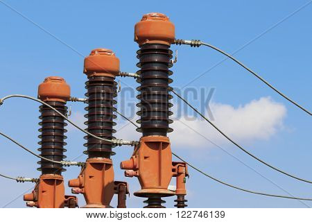 Power plant detail red high voltage isolation on blue sky