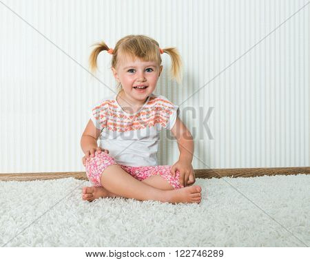 2-year-old girl engaged in physical activity at home