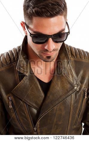 Handsome man wearing leather jacket acting like a bad boy