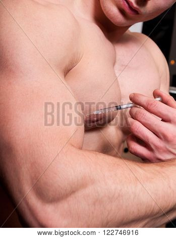 Body Builder Injecting Steroids