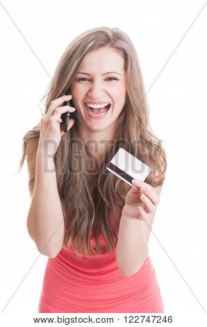 Lady Showing A Credit Card While Talking On The Phone