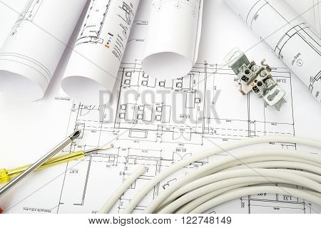 Architecture plan and rolls of blueprints with cable. Building concept