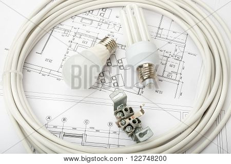 Architecture plan and rolls of blueprints with light bulbs. Building concept