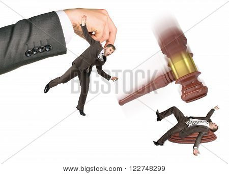 Inscribed gavel hitting scared businessman isolated on white background. Justice concept